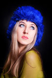 Beautiful young woman in blue winter hat Stock Photo