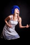 Beautiful young woman in blue winter hat Stock Photos