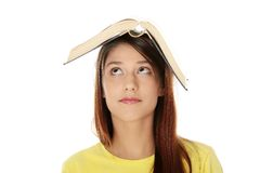 Beautiful young woman with book Royalty Free Stock Photos