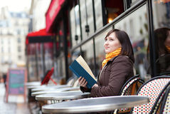 Beautiful young woman with a book in cafe Royalty Free Stock Photo