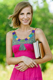Beautiful young woman with books Stock Photography