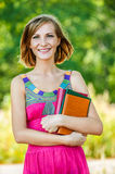 Beautiful young woman with books Stock Photos