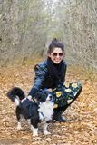 Beautiful young Woman with border collie Dog. Beautiful young woman in the autumn park with her dog royalty free stock photo