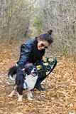 Beautiful young Woman with border collie Dog. Beautiful young woman in the autumn park with her dog royalty free stock photography