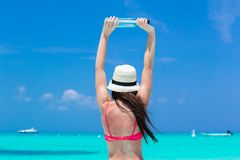 Beautiful young woman with bottle on the beach Stock Photo