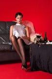 Beautiful young woman in boudoir Stock Image