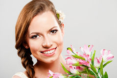 Beautiful young woman with a bouquet of flowers Stock Images