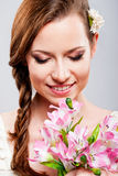 Beautiful young woman with a bouquet of flowers Royalty Free Stock Photography