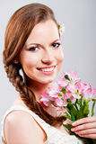 Beautiful young woman with a bouquet of flowers Royalty Free Stock Image