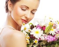 Beautiful young woman with bouquet flowers Royalty Free Stock Image