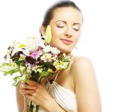 Beautiful young woman with bouquet flowers Royalty Free Stock Photography