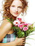 Beautiful young woman with bouquet flowers Stock Image