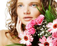 Beautiful young woman with bouquet flowers Royalty Free Stock Photo