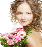 beautiful young woman with bouquet flowers stock images