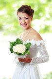 Beautiful young woman with bouquet outdoor Royalty Free Stock Photos