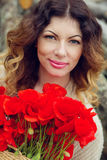 Beautiful young woman with a bouquet of poppies Royalty Free Stock Photography