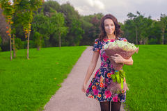 Beautiful young woman with bouquet of white roses Royalty Free Stock Image