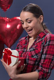 Beautiful young woman with box heart gift Royalty Free Stock Photography