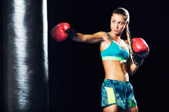 Beautiful Young Woman Boxing with Red Gloves Royalty Free Stock Images