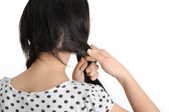 Beautiful young woman braid one's hair Royalty Free Stock Images