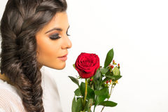 Beautiful young woman braided hair red rose stock photo