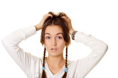 Beautiful young woman with braids in shock holding Stock Photo