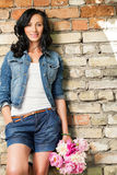 Beautiful young woman at the brick wall Royalty Free Stock Photos