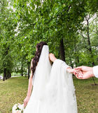 Beautiful young woman bride holds the hand of a man in outdoors. Follow me Royalty Free Stock Image