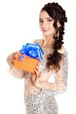 Beautiful young woman with a bright gift Stock Image