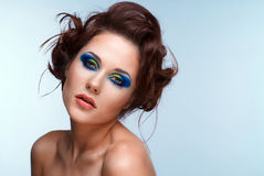 Beautiful young woman with  bright make-up Stock Images