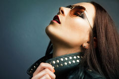Beautiful young woman with bright make-up and leat Stock Photography