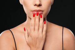 Beautiful young woman with bright manicure on black background. Nail polish trends stock image