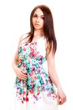 Beautiful young woman in a bright many-coloured dress Royalty Free Stock Image