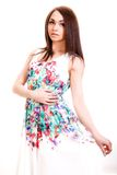 Beautiful young woman in a bright many-coloured dress Stock Photography