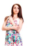 Beautiful young woman in a bright many-coloured dress Royalty Free Stock Photo