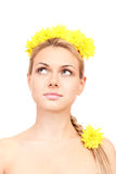 Beautiful young woman with bright yellow flowers Stock Photos