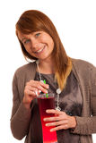 Beautiful young woman in brown dress with a glass of ice tea Royalty Free Stock Image