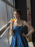 Beautiful Young Woman with Brown Hair Drinking Glass of Mango Ju Stock Photos
