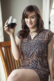 Beautiful Young Woman in Drinking Red Wine Royalty Free Stock Photos