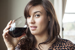 Beautiful Young Woman in Drinking Red Wine Royalty Free Stock Photo