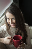 Beautiful Young Woman with Brown Hair and Eyes Drinking Coffee stock photography