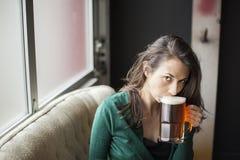 Beautiful Young Woman Holding Mug of Beer Stock Photos