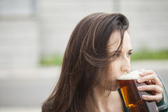 Beautiful Young Woman Holding Mug of Beer Stock Image