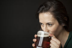 Beautiful Young Woman Holding Mug of Beer Royalty Free Stock Photos