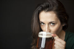 Beautiful Young Woman Holding Mug of Beer stock photos