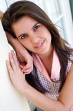 Beautiful young woman with brown hair smiling Stock Photography
