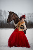 Beautiful young woman with a brown horse Stock Photo
