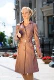 Beautiful Young Woman in brown raincoat Stock Photo