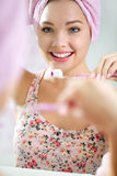 Beautiful young woman brushing her teeth Royalty Free Stock Photos