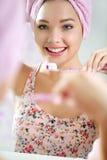 Beautiful young woman brushing her teeth. Beautiful healthy young woman brushing her teeth Royalty Free Stock Photos